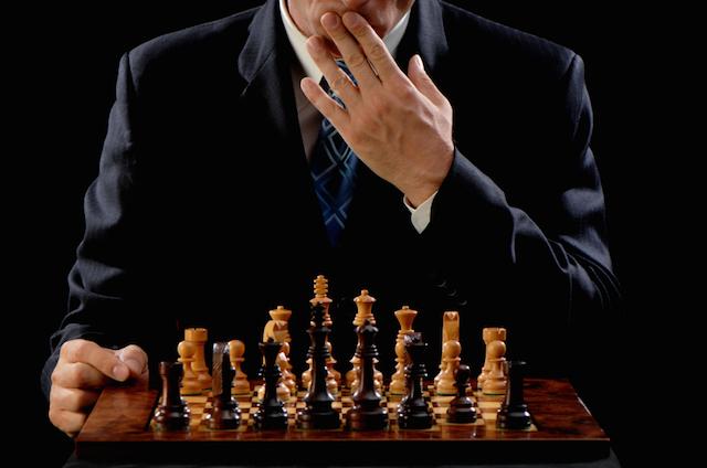 Man Winning Chess Game on White